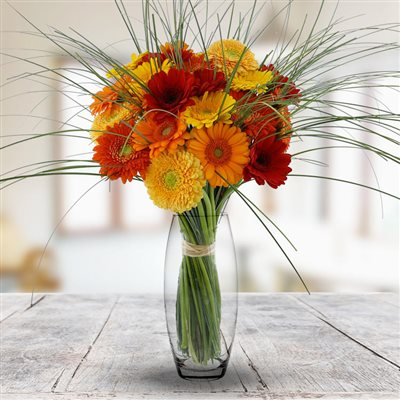 Bouquet de germinis tons chauds et son vase