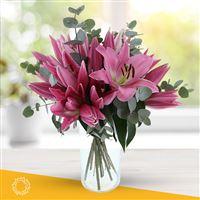 Bouquet de lys roses et son vase