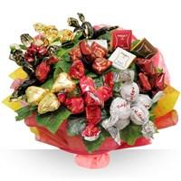 Un bouquet gourmand réalisé avec les confiseries de la célèbre maison Maxim's...