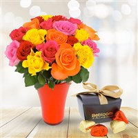 Profitez de cette offre 3 en 1 avec roses, vase et chocolats pour offrir un cadeau étonnant : une brassée de 20 roses accompagnée d'un joli vase design et d'une boîte élégante de cœurs au chocolat praliné griffée le Fleuriste Gourmand.